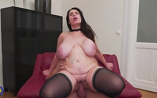 Mature brunette, Josephine James is bouncing with regard to and down while riding a rock hard dick