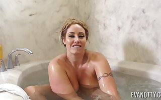 Chubby exasperation cougar sits defoliated in the tub and feels very horny