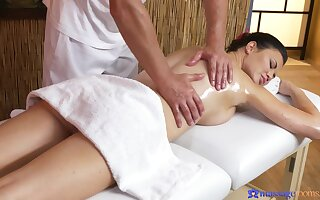 Buxom dark-haired MILF appreciates full-service rub-down
