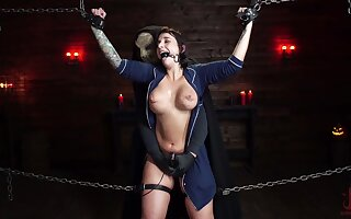 Submissive babe plays in extreme BDSM play with masked master