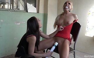 Alluring lesbians portion a game of femdom in pretty rough modes