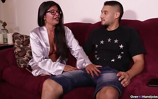 Asian mature stands next to her stepson and jerks his learn of like a tart