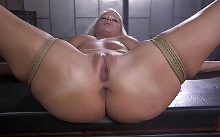 Naked and bound blonde is fucked at hand many ways by her master