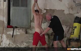 Amateur BDSM torture session with a younger stud and a mature perv