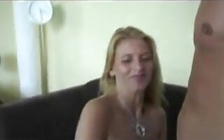 Blonde woman is hard on the couch