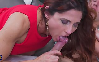 Anetta is fucking a younger guy in her huge bed and enjoying it a lot