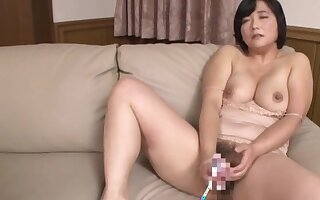 Busty Japanese mature loads her bush with millions of cock