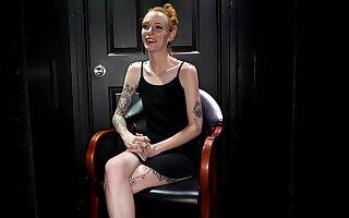 Tattooed, ginger newborn with small tits, Faye is sucking a hard Hawkshaw through a gloryhole