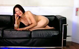 She likes to wear heels and she loves talking on the phone while being naked