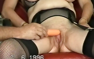 Brunette mature wife  bends over and toys her pussy