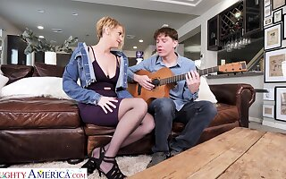 Young scrounger learns sexy milf how to play a guitar and she teaches him a true sex lesson