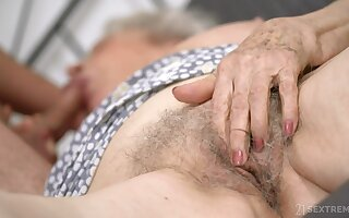Senile granny concerning big boobs Norma B gets intimate concerning young man