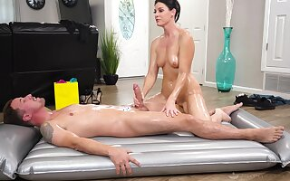 Hot mature gives young lad make an issue of massage of his life