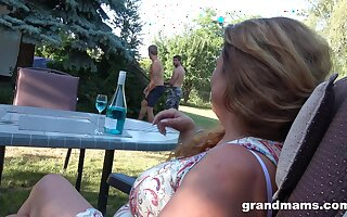 Rich mature lady hires two young men as the brush gardeners coupled with she wants their cocks