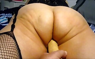Wife working her big irritant with 10 inch dildo