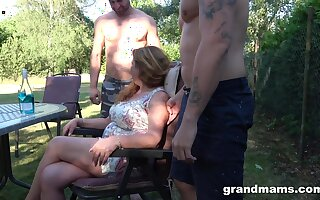 Husband is obeying his mature spliced fucking two horny young dudes in the garden