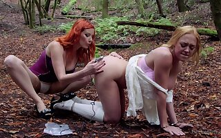 Dee Williams submits to Maitresse Madeline Marlowe during open-air Lezdom