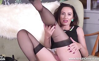 Brunette teases in coloured nylons be required of you to wank