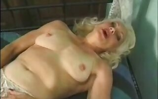 Mature auburn bitch masturbates her gungy old pussy with a toy